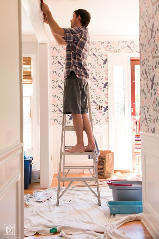 how to hang wallpaper and cut off excess at ceiling