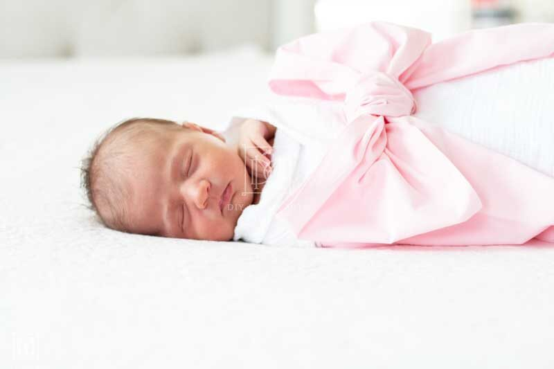 newborn girl with swaddle
