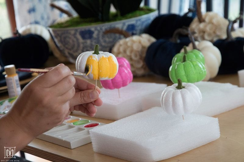 hand painting DIY colorful pumpkins yellow pink and green