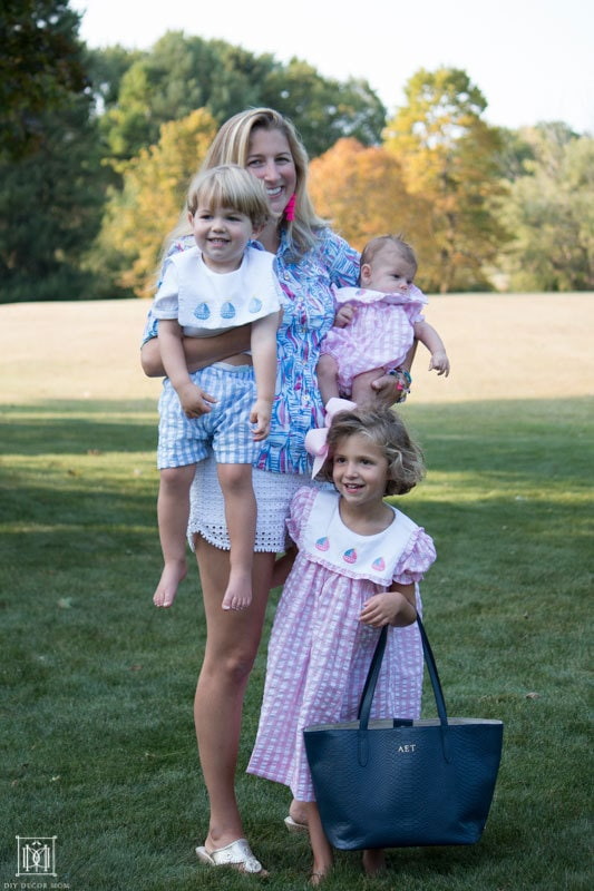 happy busy family with mom of three holding three kids