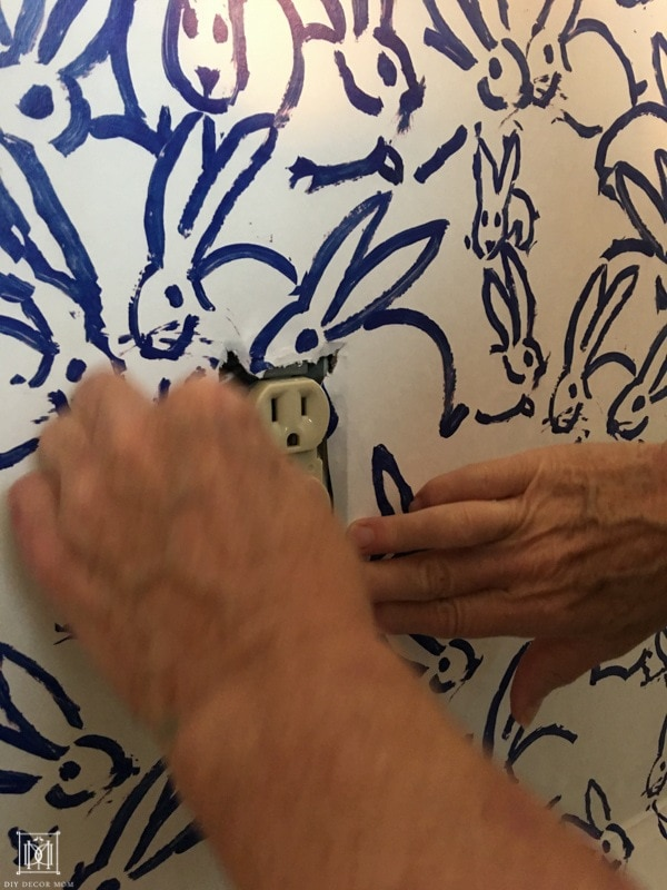 how to hang wallpaper around electrical outlets