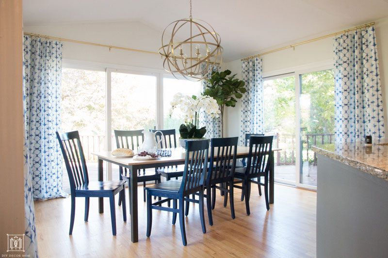 gold chandelier and kitchen breakfast table with blue dining chairs