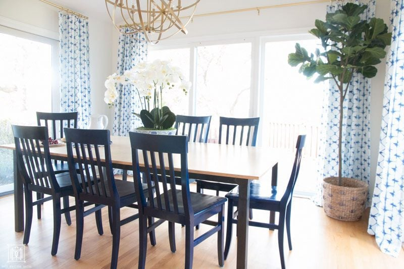 kitchen table in breakfast room with blue dining room chairs