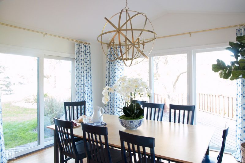 gold chandelier in morning room with eat in kitchen table