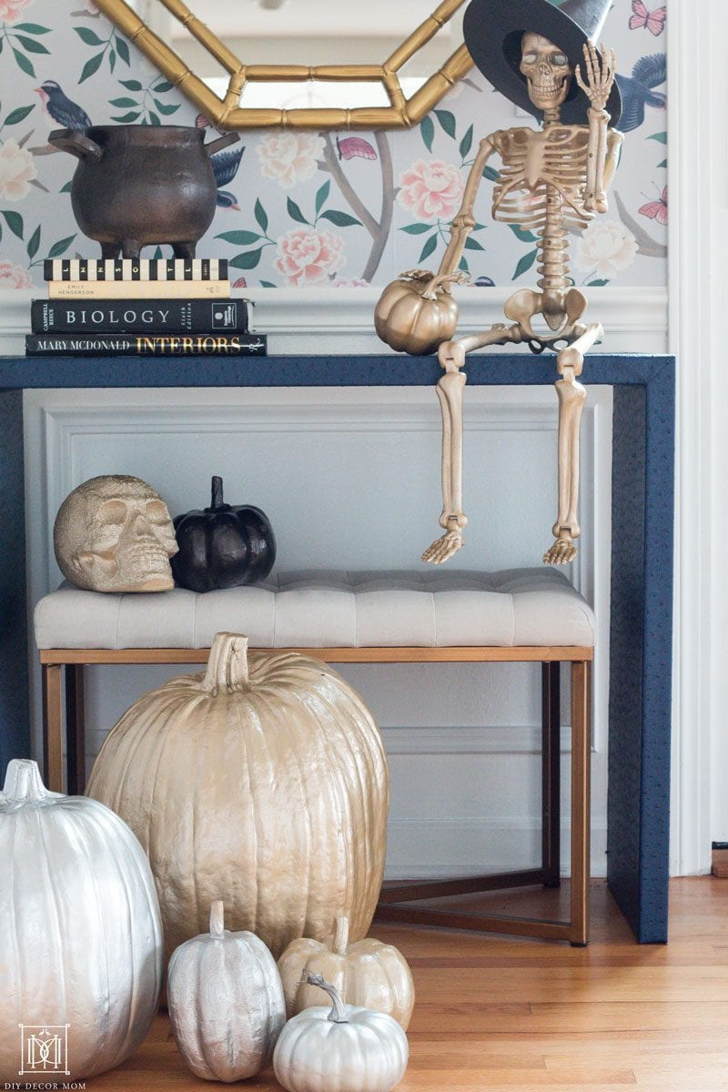 gold halloween pumpkins and skeleton