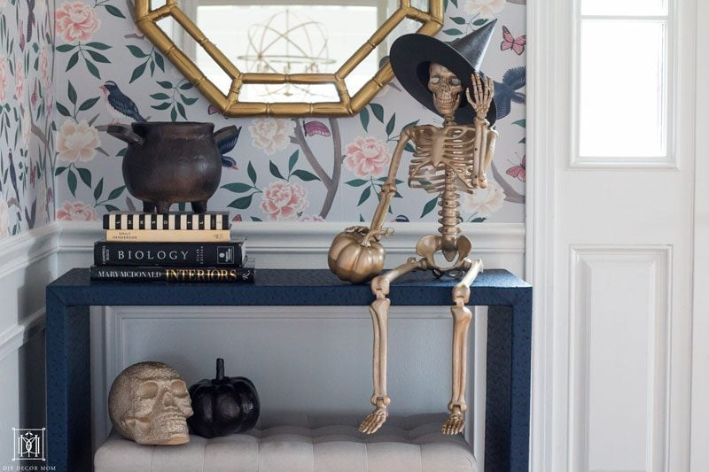 gold halloween decor in front hall with chinoiserie wallpaper