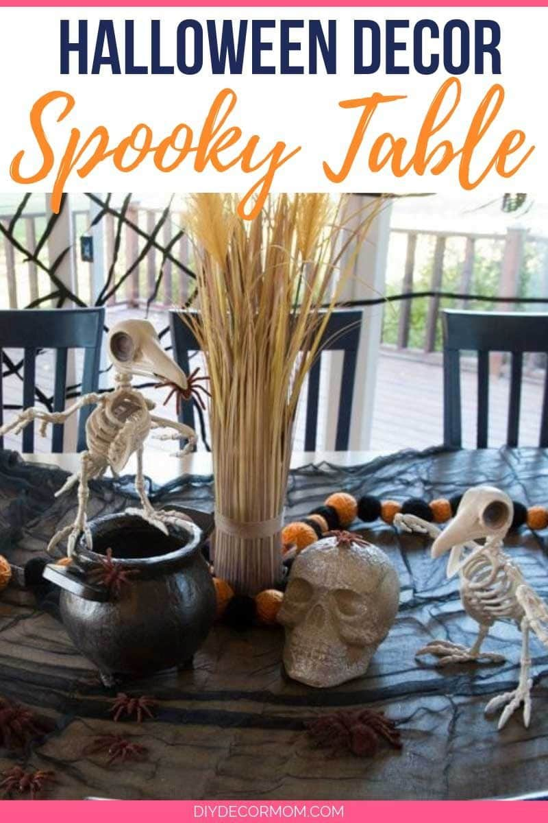 halloween table decor ideas with black tablecloth skeleton skull and spiders