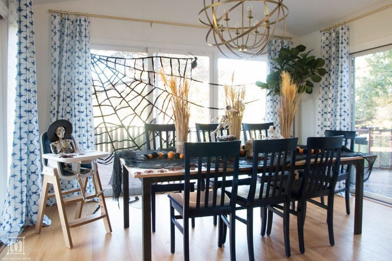 halloweentable decorations and halloween tablescape in breakfast room with skeleton