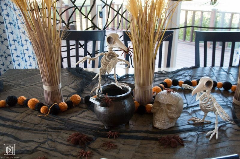 halloween decor ideas for table kids party with skeletons, skulls, and spiders