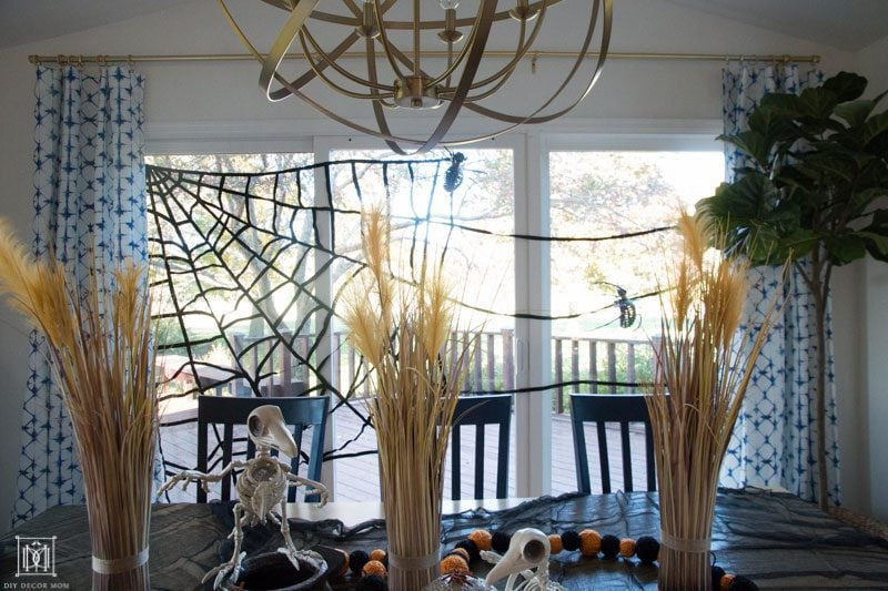 breakfast table decorated with halloween decor ideas and skeletons