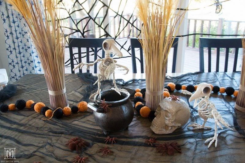 halloween table decor ideas with skeletons spiders and skulls