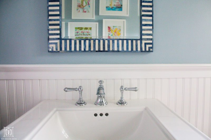 add artwork to make a small bathroom seem bigger