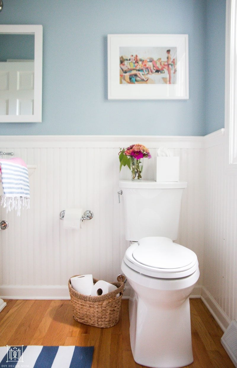 small toilet with elongated bowl that makes bathroom seem larger