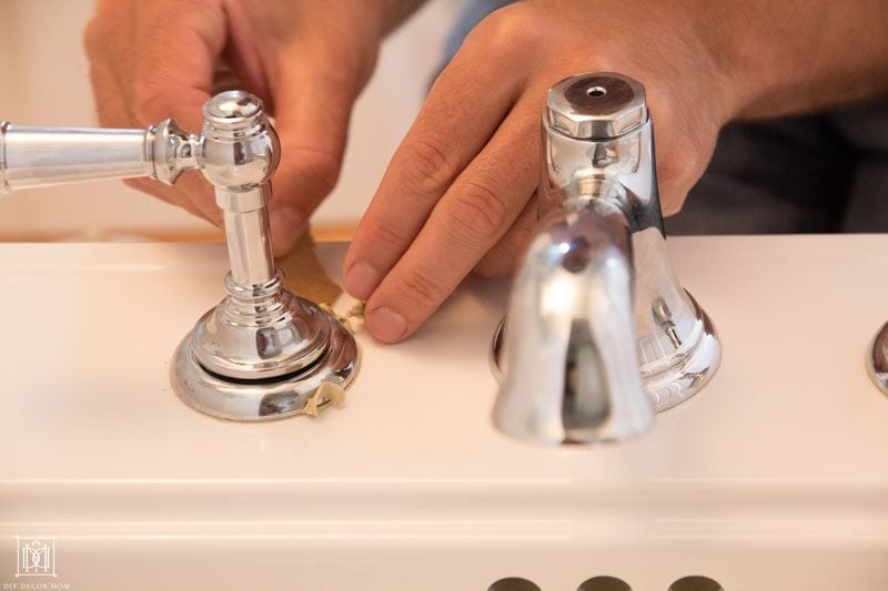 tips for making a small bathroom look bigger like installing matching faucets on pedestal sink