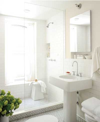 airy light greige walls in bathroom with subway tile and pedestal sink