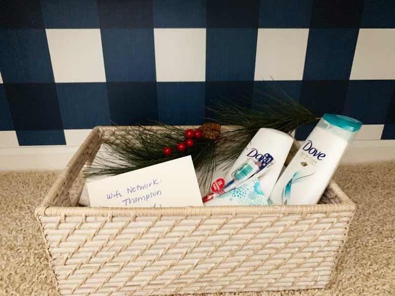 guest room welcome basket in linen closet