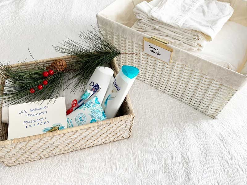 organized linen closet with guest room welcome basket