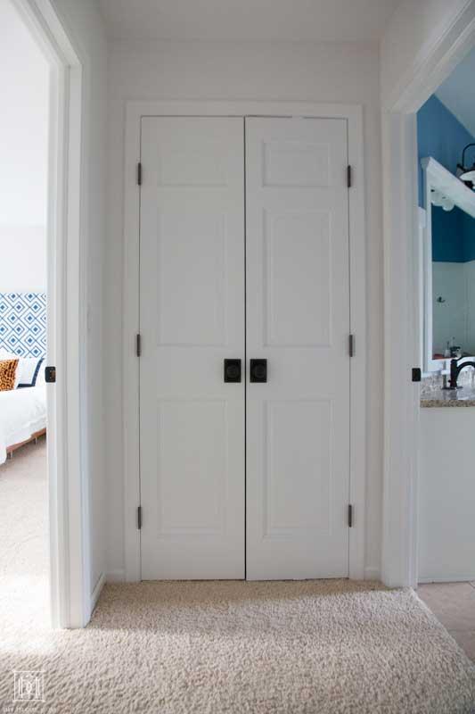 white hallway doors of linen closet