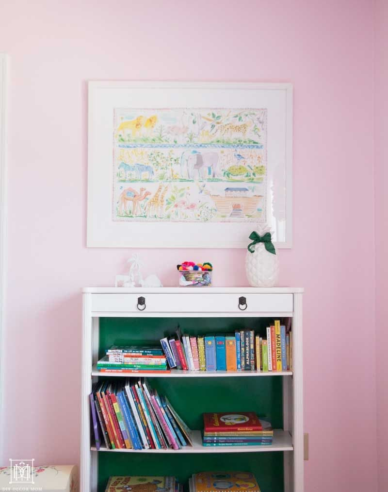 little-girls-room-with-pink-walls-and-vintage-green-and-white-bookcase