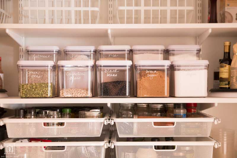 organized baking supplies in pantry with deep shelves