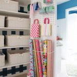 gift wrapping organizer in linen closet