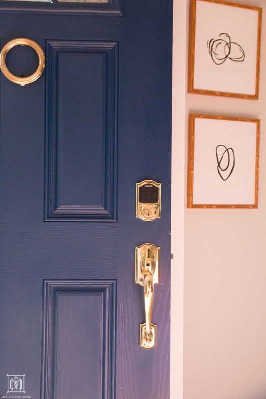 wipe down door hardware- gold hardware on blue door for spring cleaning checklist and calendar