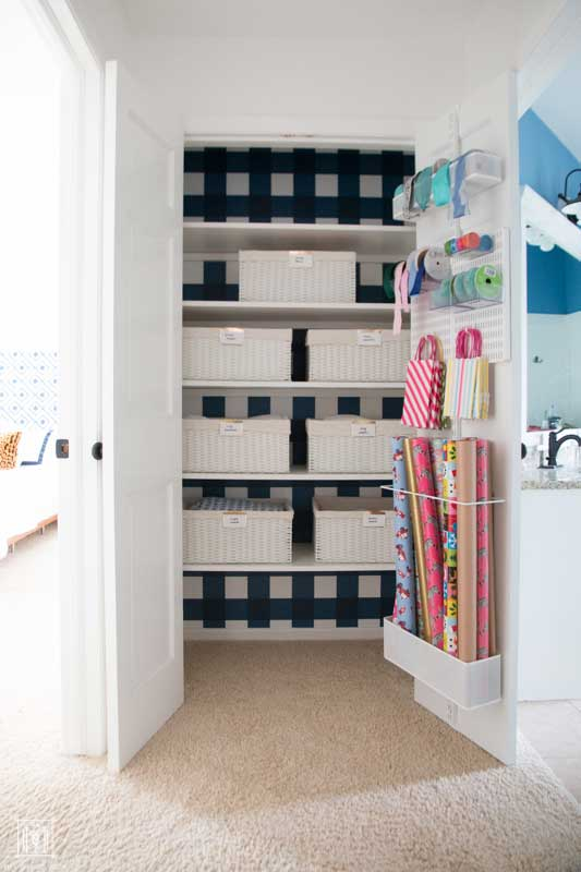 how to organize a linen closet- blue and white linen closet with white baskets