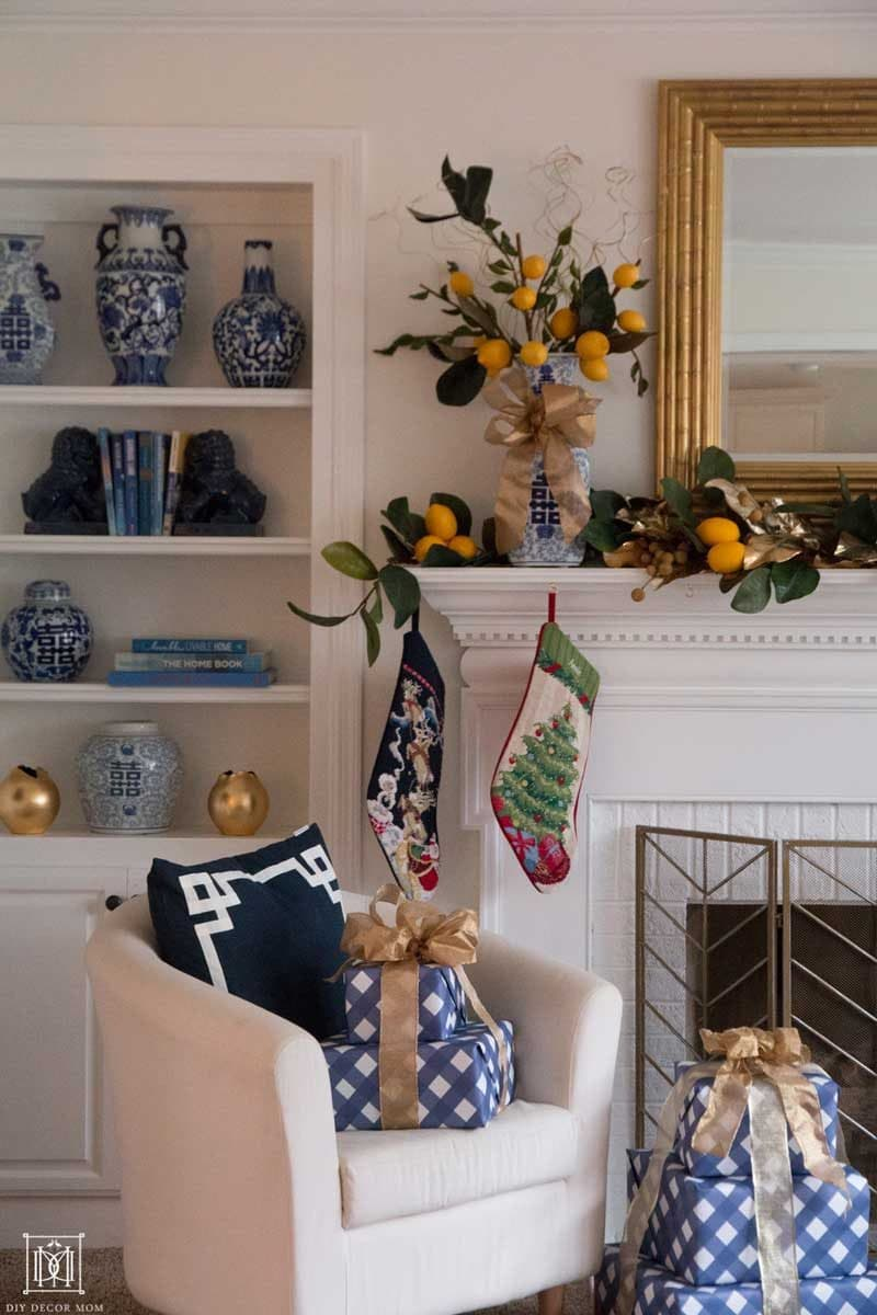 fireplace decorated with faux lemon garland