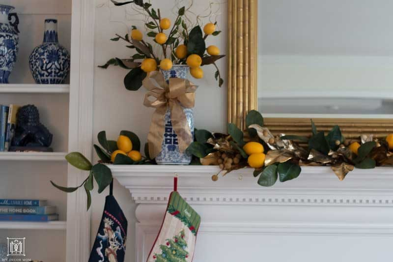 faux lemons and citrus garland on fireplace mantel