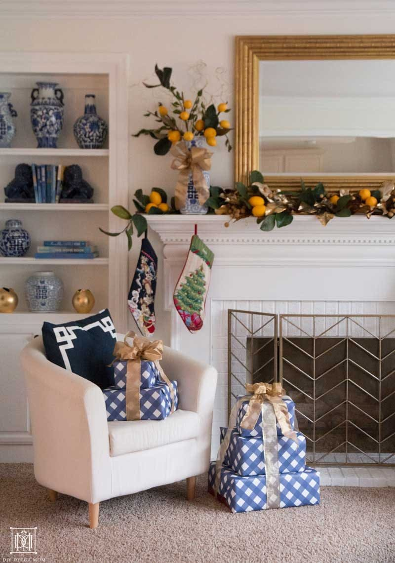 christmas fireplace with lemon garland and blue and white pottery