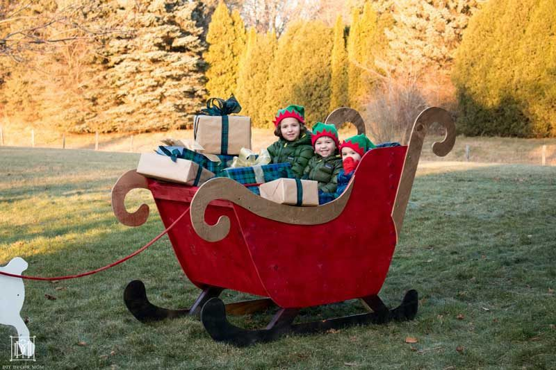 kids in wooden diy sleigh