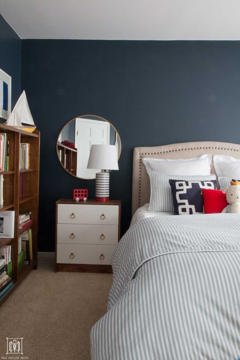 gorgeous navy blue bedroom with nautical theme perfect for little boys bedroom