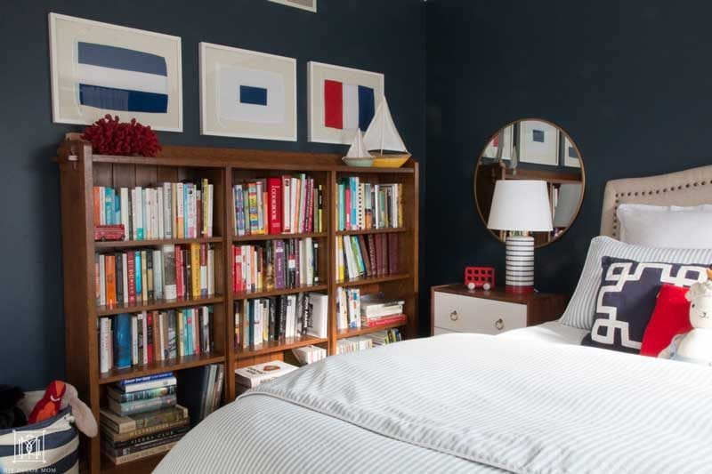 nautical bedroom for a little boy with navy walls and bookcase