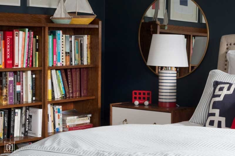 nautical themed bedroom with bookcase and boats