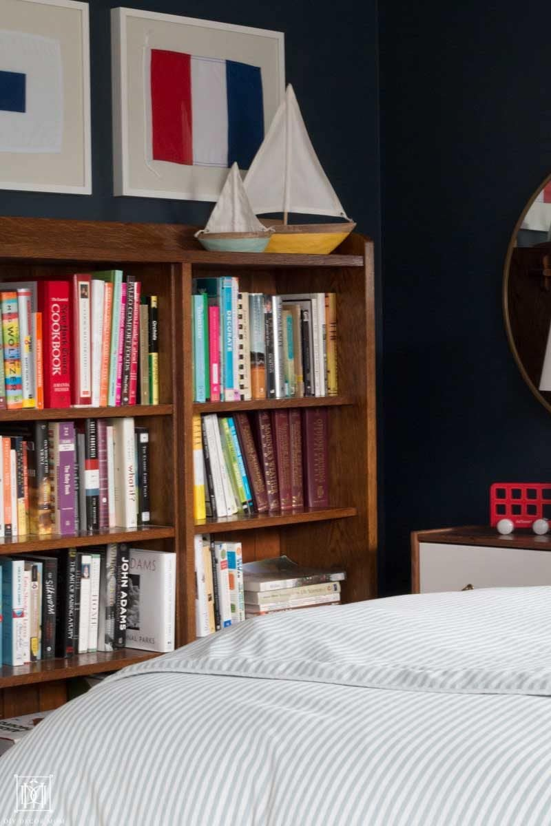 nautical bedroom decor vignette of bookcase with mini boats