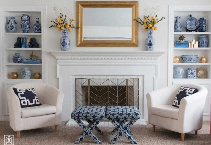 how to decorate a bookcase- white painted built ins and painted brick fireplace