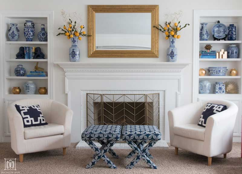 warm white walls with blue and white pottery and fireplace