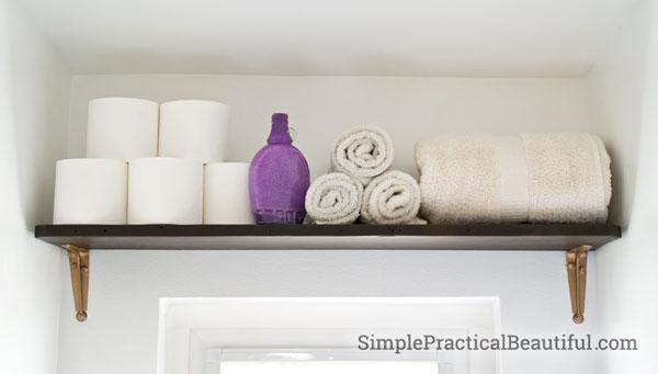 DIY bathroom storage shelf over window and door by Simple Practical Beautiful