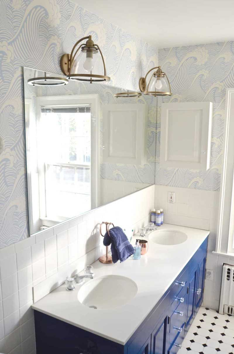 blue bathroom vanity in shared kids bathroom
