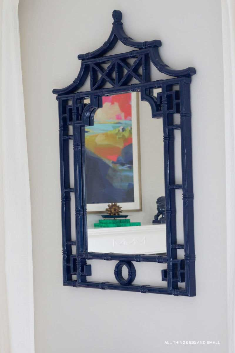 tip to make your bedroom look nice- add mirrors to magnify light