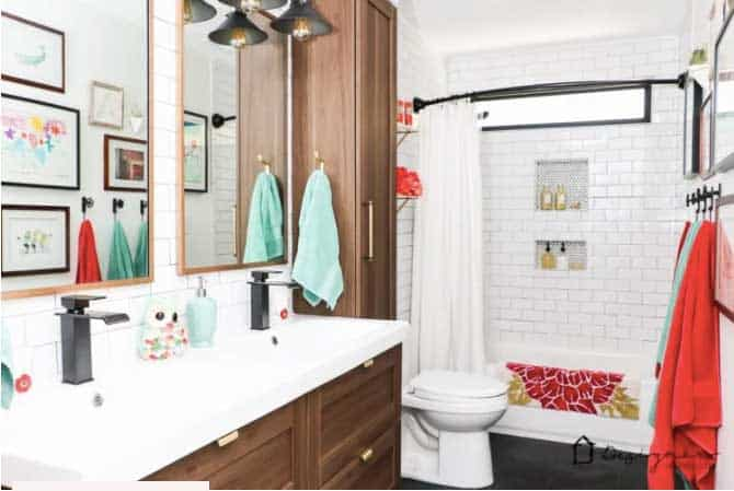shared girls bathroom with wood cabinets and subway tile