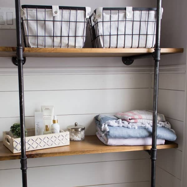 DIY pipe shelves in bathroom by house by the bay design