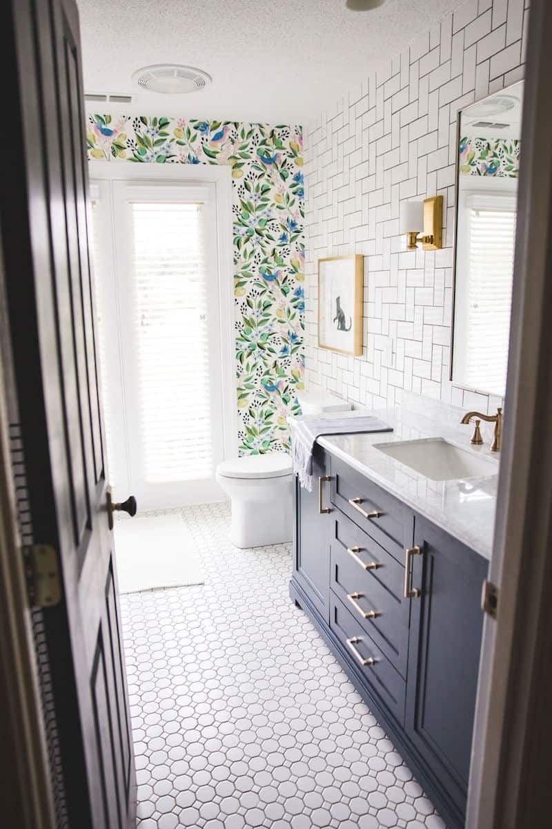 gorgeous wallpaper and tiled girls bathroom