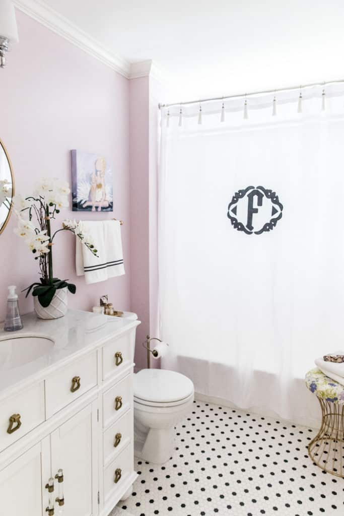 lilac painted girls bathroom and monogrammed shower curtain
