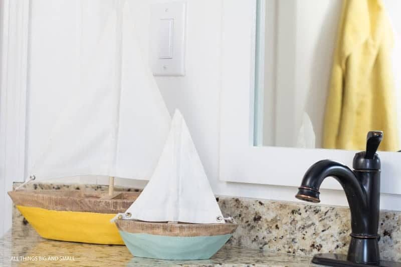 two boats on bathroom counter- kids bathroom decor ideas
