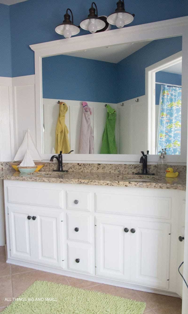 kids bathroom makeover ideas- shared kids bathroom with board and batten