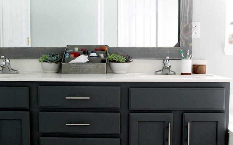 dark vanity with light gray bathroom- Tag and Tibby