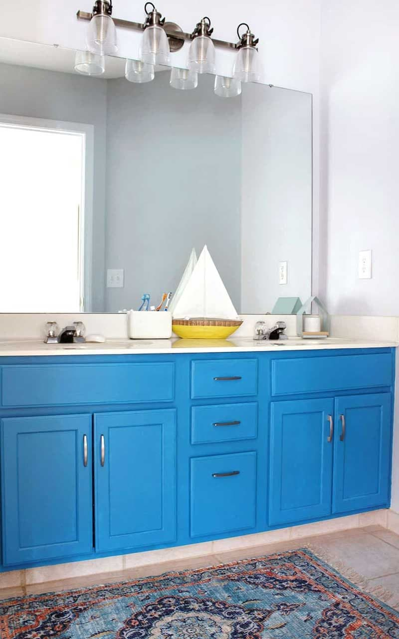 bright blue bathroom cabinets in kids bathroom