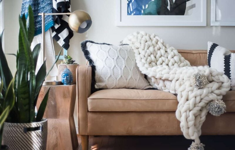 arm knit throw blanket by A Place of My Taste on a couch--great idea for decorating your bedroom