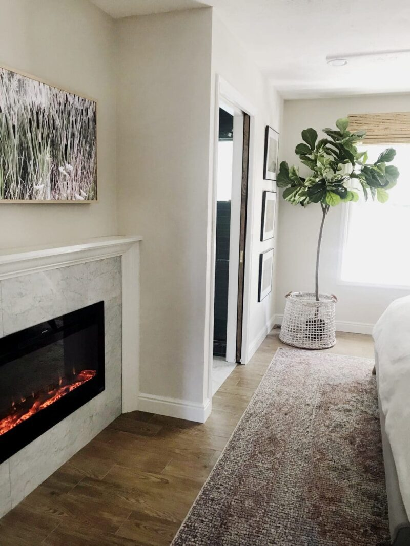 install a fireplace in your master bedroom like Chris Loves Julia did in their master